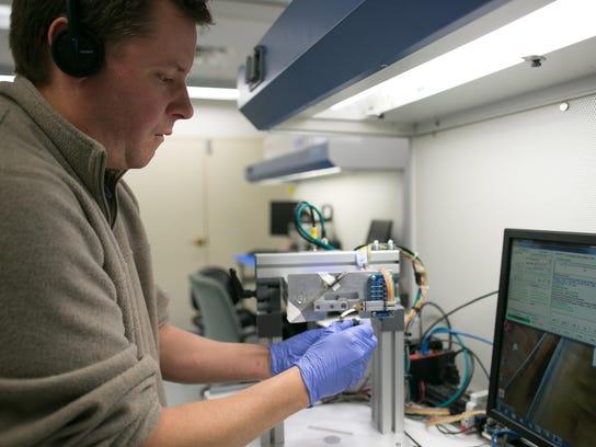 Jason Austin of Walworth runs a test at New Scale Technologies