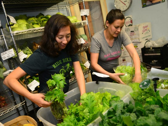 Mary Walsh, left, and Jac Oliver package lettuce at