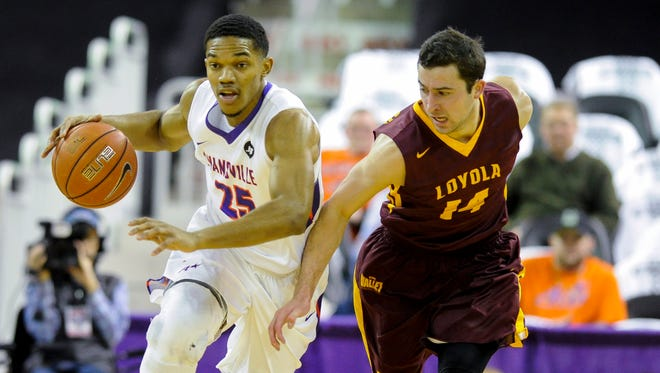 Evansville Aces guard Duane Gibson (25) drives past Loyola Ramblers guard Ben Richardson (14) during their game at the Ford Center in Evansville, Wednesday, Feb. 8, 2017. Evansville beat Loyola 60-58.