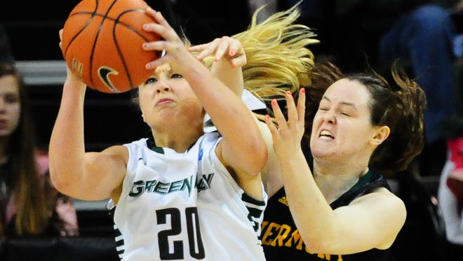 University of Wisconsin-Green Bay's Jessica Lindstrom grabs a rebound in front of Vermont's Jordan Eisler during the first half of the game at the Kress Events Center, Saturday, December 20, 2014. H. Marc Larson/Press-Gazette Media/@HMarcLarson