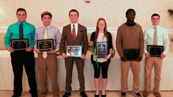 (From left) Michael Clavier of Caesar Rodney, Alexander Spahr of Charter of Wilmington, Nathaniel Vincent of Delmar, Sara Davis of Woodbridge, Kalen Wilson of Smyrna and Shane Cawman of Delaware Military Academy each received $8,000 college scholarships from the Delaware Wrestling Alliance.