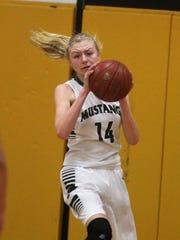 Brossart freshman Marie Kiefer pulls down a rebound
