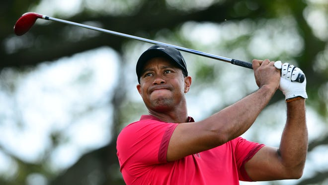 Tiger Woods, shown with driver at Doral in March, is back taking full swings after back surgery. There is no timetable for his return.