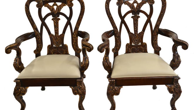 A reproduction 20th century Chippendale six-piece chair set sold at auction in July 2014 for $900.