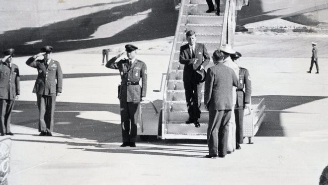 Pres. John F. Kennedy descending stairs from USAF plane at Palm Springs Airport.