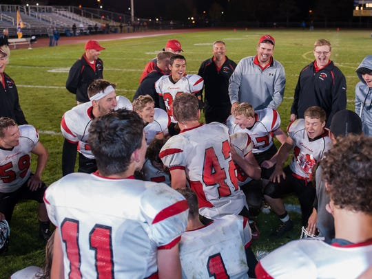 Coach Ted Hardenstine shares a light moment with the