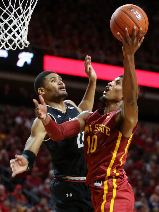 Iowa State forward Darrell Bowie is fouled by Cincinnati forward Kyle Washington as he goes up for a shot during the first half of an NCAA college basketball game, Thursday, Dec. 1, 2016, in Ames, Iowa. (AP Photo/Justin Hayworth)