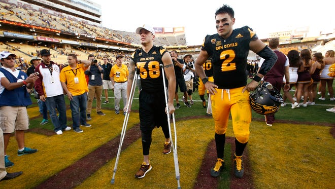 ASU defensive back Jordan Simone (38) leaves the field on crutches after suffering a knee injury against Washington on Nov. 14, 2015 in Tempe.