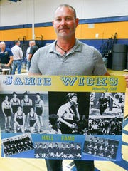 Jamie Wicks, wrestling great from the '80s, and the other honorees got to take home the posters that were part of the induction-ceremony décor.