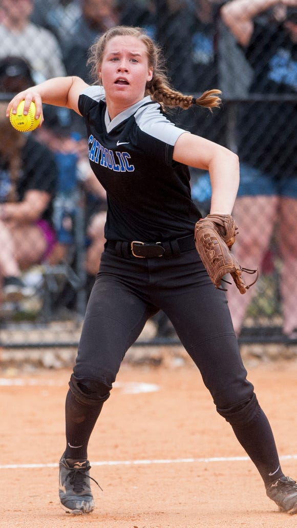 Montgomery Catholic's Michaelyn Foster throws to first