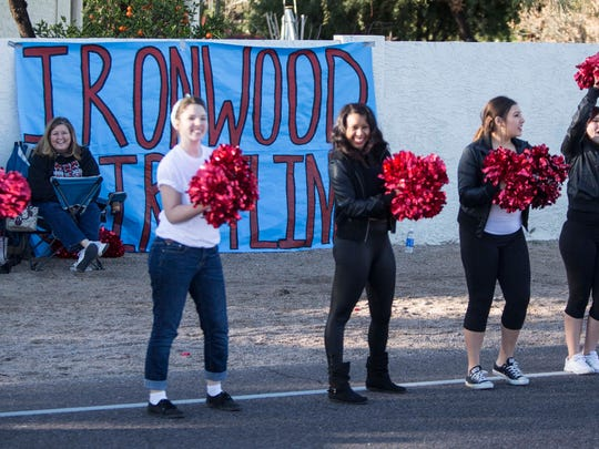 The Ironwood Cheer line performs a cheer for the runners