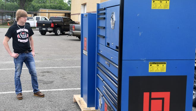 Kelly Smythe looks at the new $21,000 MATCO Master Work Station and Tool Storage Unit at South Side High School, Monday, May 21. Smythe was selected as one of 12 winners of a national video contest by Lincoln Tech, a technical college in Nashville. Smythe also received a $1,700 MATCO tool box and set for himself.