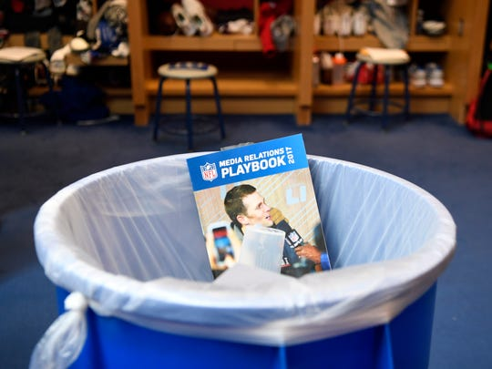 A media relations playbook sits in the trash as the