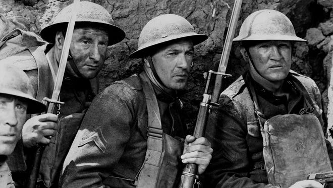 "Gary Cooper (center)  plays the role of Alvin York, a heroic World War I soldier from Tennessee, in the 1941 classic ""Sergeant York."""