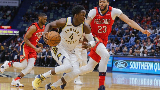Indiana Pacers guard Victor Oladipo (4) drives past New Orleans Pelicans forward Anthony Davis (23) during the first quarter at the Smoothie King Center.