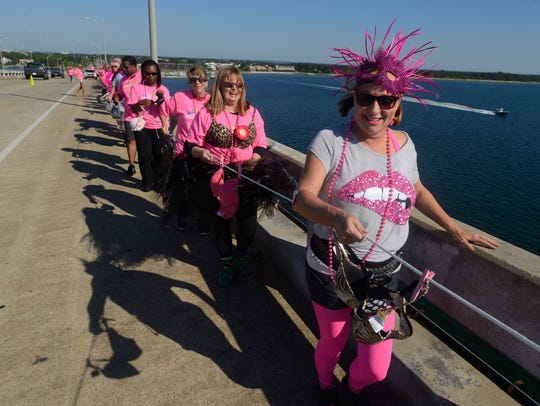 Walkers make their way over the Bob Sikes Bridge during a previous Bras Across the Bridge. Sponsorships are now available for this year's event.