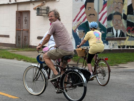 Hundreds of cyclists participate in the Slow Ride on July 7. Each month, local riders gather for a leisurely cruise through the streets of Pensacola's historic neighborhoods.