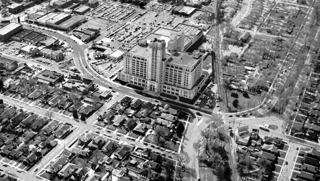 MIDTOWN SHOPPING HUB.  Sears, Roebuck and Company dominated the Midtown landscape at North Watkins and North Parkway in early April 1955.  The old Louisville & Nashville Railroad tracks run top to bottom of the photograph to the right side of the Sears building.  Galloway runs almost into the front door of the building and North Parkway winds its way across the railroad tracks to the right of the building.  The photograph is taken looking toward the west from above North Parkway.  McNeil is seen at the extreme lower left of the photo and Garland is the second street from the bottom of the photograph.  The Commercial Appeal files.