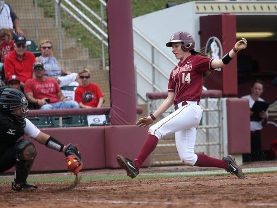 FSU's Ellie Cooper is out on the force at home plate