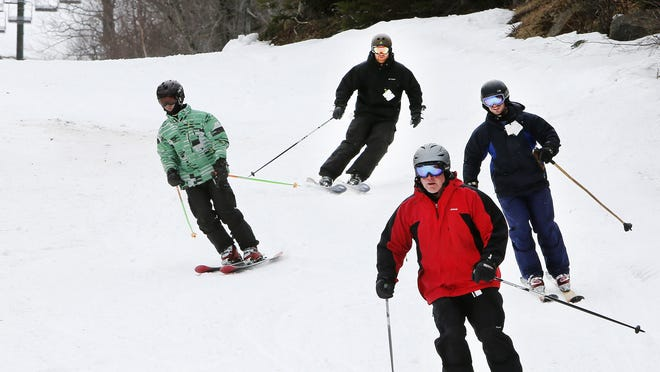 In this photo taken Saturday April 25, skiers are seen at Wildcat ski area in Gorham, N.H.