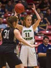 Snow Canyon's Nikenna Durante looks to pass the ball during the game against Pine View in Friday's 3A semifinal matchup at the SUU Centrum, Feb. 26, 2016.