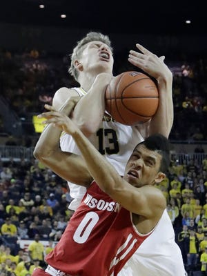 Guard D'Mitrik Trice and the Badgers struggled against Michigan on Thursday night.