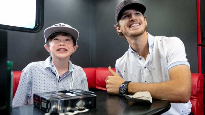 PGA TOUR pro Morgan Hoffmann smiles with Wyatt Rownd, 13, of New Orleans, in the Titleist equipment truck during the first day of The Honda Classic on Monday at PGA National Resort & Spa. Hoffmann took Rownd and his family on a behind-the-scenes tour of the tournament. Both Hoffmann and Rownd have muscular dystropy.