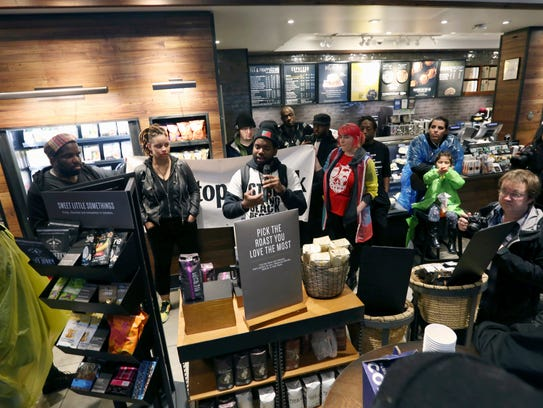 Demonstrators occupy the Starbucks that has become