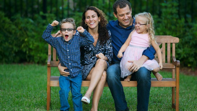 Laura and Matt Grabinski with their 5-year-old twins Leo and Lola. Leo and Lola are the official child artists for the 2017 Southwest Florida Wine & Food Fest.