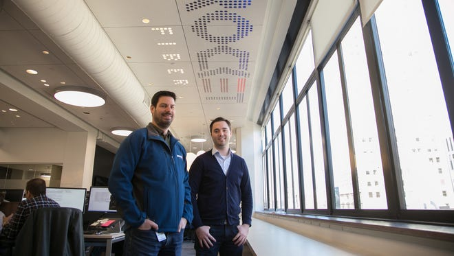 Rocket Fiber Co-Founder and Chief Technology Officer Randy Foster (left) and Co-Founder and CEO Marc Hudson pose for a photo at the Rocket Fiber office on Woodward Ave. in downtown Detroit on Wednesday November 25, 2015.