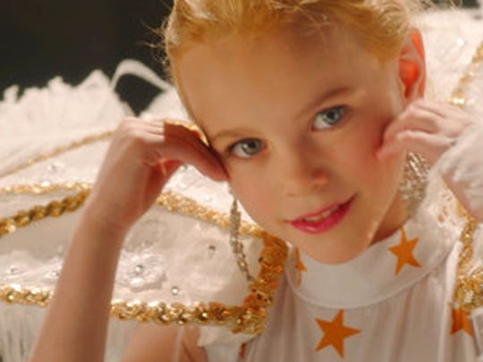 """This image released by Netflix shows Hannah Cagwin in a scene from, """"Casting JonBenet."""""""