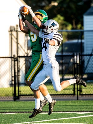 Lucas Pierce of Newark Catholic catches a pass from Hunter Chapman during a Jamboree game against Granville Friday night.