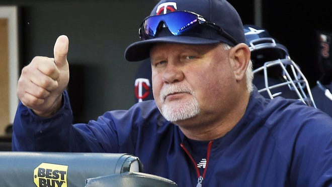 """Minnesota Twins manager Ron Gardenhire signals """"good luck"""" to Cleveland Indians manager Terry Francona, as the Indians clinched an American League playoff spot with a 5-1 win over the Twins at Target Field in Minneapolis, Minn. on Sunday, Sept. 29, 2013. The game was also Gardenhire's last as skipper of the Twins."""