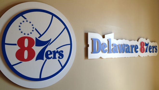 The Delaware 87ers logo hangs on the wall in the NBA Development League team's office in Wilmington.