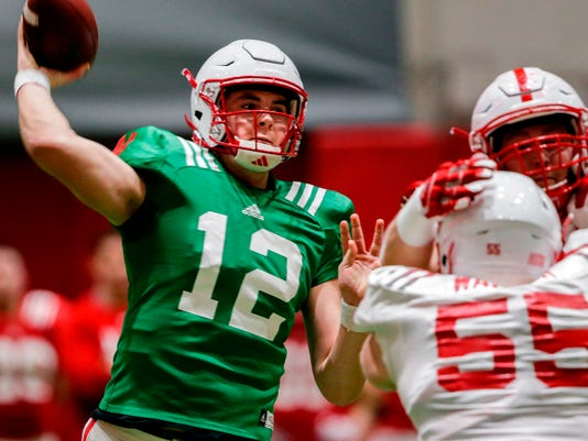 FILE - In this April 3, 2018, file photo, Nebraska quarterback Patrick O'Brien (12) throws during spring training in Lincoln, Neb. Spring practice is just past the midway point at Nebraska, and new coach Scott Frost is beginning to flesh out a quarterback pecking order.  (AP Photo/Nati Harnik, File)