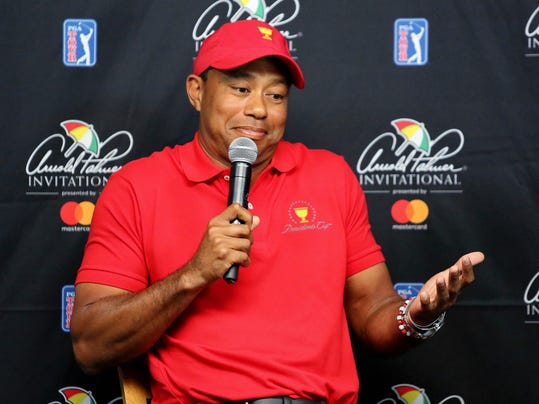 Tiger Woods shrugs while responding to a reporter's question during a news conference at the Arnold Palmer Invitational golf tournament at Bay Hill, Tuesday, March 13, 2018, in Orlando, Fla. At Bay Hill, Woods has won eight times and twice ended long victory droughts. (Joe Burbank/Orlando Sentinel via AP)