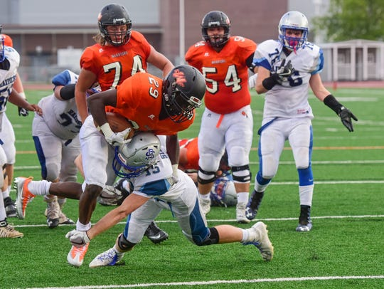 Washington's Zaki Ladu ran for 204 yards and a touchdown in a win over Lincoln.