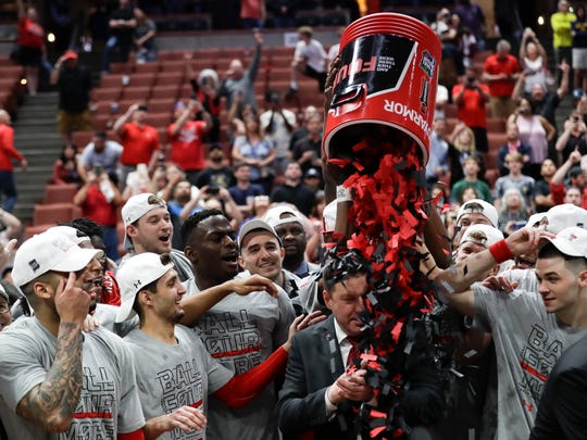 Texas Tech players shower coach Chris Beard with confetti after their win against Gonzaga during the West Regional final in the NCAA men's college basketball tournament Saturday in Anaheim, Calif. Texas Tech won 75-69.