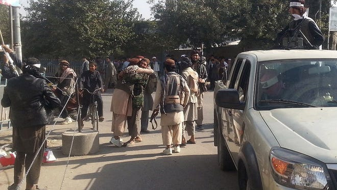 Taliban fighters hug each other a day after they overran the strategic northern city of Kunduz, Afghanistan, on Sept. 29, 2015.