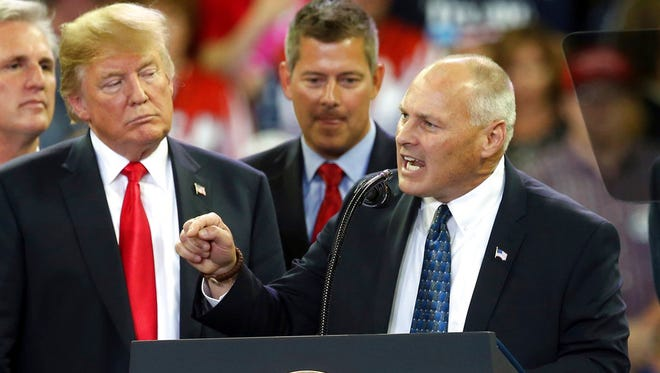 President Donald Trump, left, listens as Republican Pete Stauber addresses the crowd in his run for Minnesota's Eighth Congressional District during a Trump rally Wednesday, June 20, in Duluth.