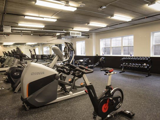 A workout room in Marketplace Apartments, at 313 N.