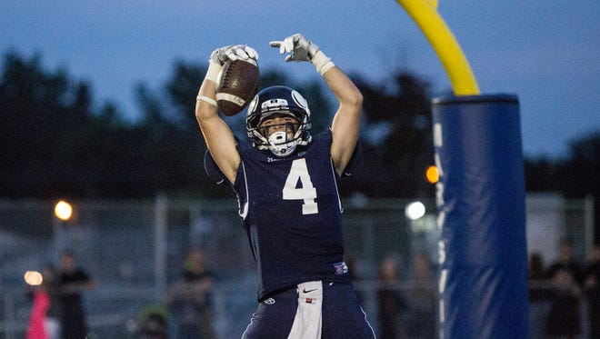 Marysville's Phill Griffor celebrates scoring a touchdown during a football game Friday, September 16, 2016 at Marysville High School.