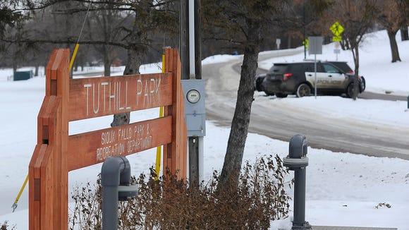 Law enforcement blocks the entrance of Tuthill Park