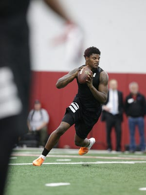 Louisville's Lamar Jackson rolls out to pass during NFL Pro day. March 30, 2018.