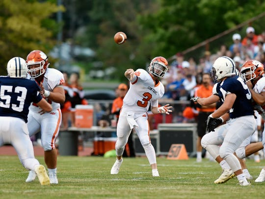 Central York quarterback Cade Pribula throws a pass