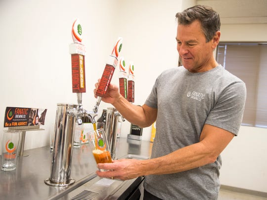Marty Velas, owner and head brewer at Knoxville's Fanatic Brewing Company, pours a pint of Fanatic's Tennessee Red at its location on 2735 N. Central St on Wednesday, February 7, 2018.