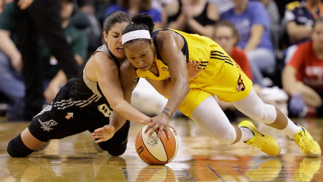 File photo: San Antonio Stars' Kelsey Plum, left, and Indiana Fever's Briann January dive for a loose ball during the second half of a WNBA basketball game, Wednesday, July 12, 2017, in Indianapolis. San Antonio defeated Indiana 79-72.
