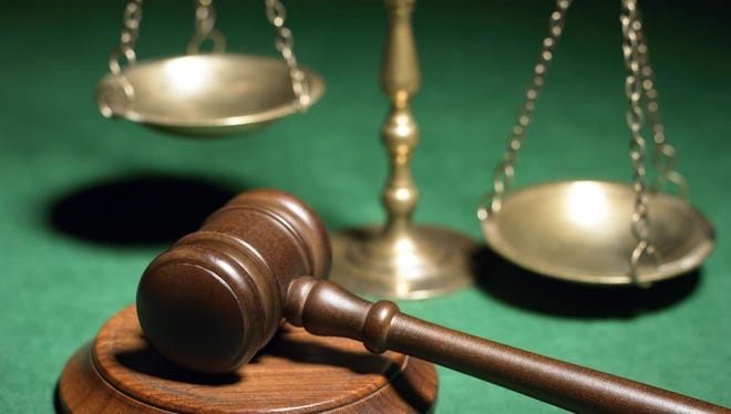 A former Greenville broker was sentenced on federal wire fraud charges.