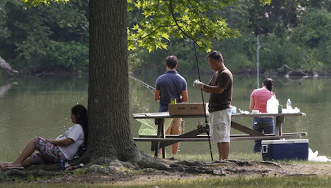 Anglers trying their luck at Lums Pond State Park.