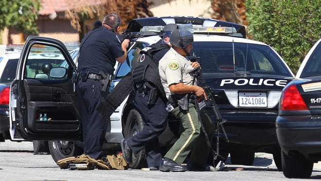 Peace officers point to a home on Cypress Road after a gunshots where fired wounding at least one seen by reporter in Palm Springs, California on October 8, 2016.